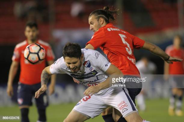 Luis Caballero of Nacional and Gaston Silva of Independiente fight for the ball during a first leg match between Nacional and Independiente as part...