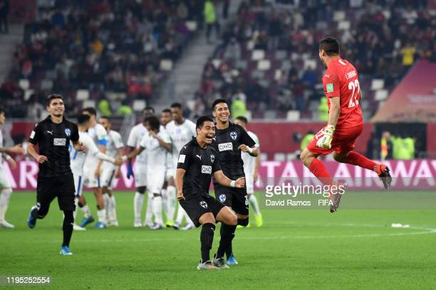 Luis Cardenas of CF Monterrey celebrates with his teammates after scoring the winning penalty during the penalty shootout which results in victory...