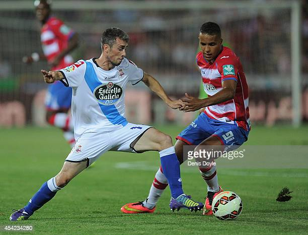 Luis Carlos alias Luisinho of RC Deportivo La Coruna in action against Youssef El Arabi of Granada CF during the La liga match between Granada CF and...