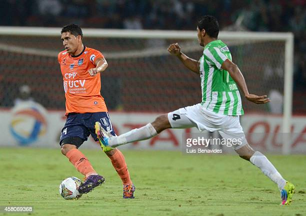Luis Carlos Ruiz of Nacional vies for the ball with Jesus Alvarez of Cesar Vallejo during a first leg match between Atletico Nacional and Cesar...