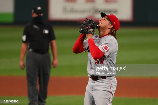 Luis Castillo of the Cincinnati Reds celebrates after recording the final out of the game against the St. Louis Cardinals with a throw to first base...