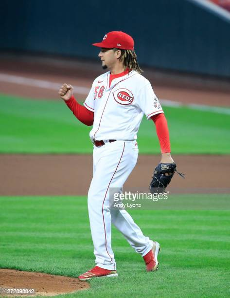 Luis Castillo of the Cincinnati Reds celebrates after the third out of the 7th inning against the Pittsburgh Pirates at Great American Ball Park on...