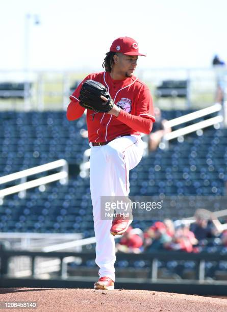 Luis Castillo of the Cincinnati Reds delivers a first inning pitch during a spring training game against the Texas Rangers at Goodyear Ballpark on...
