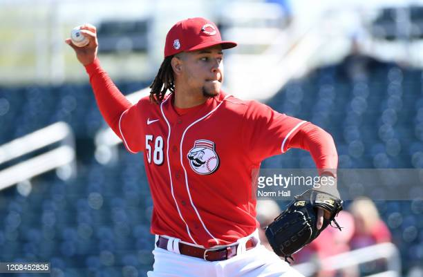 Luis Castillo of the Cincinnati Reds delivers a first inning pitch against the Texas Rangers at Goodyear Ballpark on February 24, 2020 in Goodyear,...