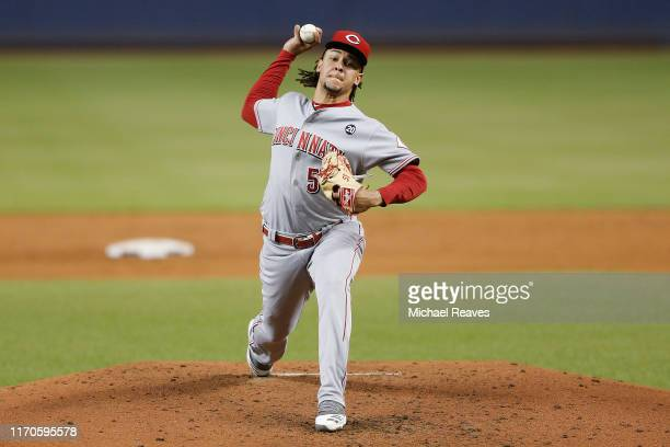 Luis Castillo of the Cincinnati Reds delivers a pitch against the Miami Marlins during the first inning at Marlins Park on August 27, 2019 in Miami,...