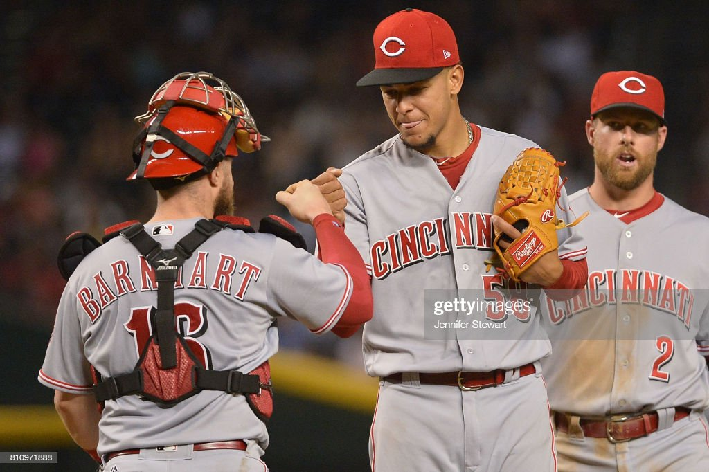 Luis Castillo #58 of the Cincinnati Reds is congratulated by Tucker Barnhart #16 after being relieved during the seventh inning of the MLB game against the Arizona Diamondbacks at Chase Field on July 8, 2017 in Phoenix, Arizona.