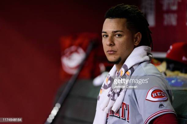 Luis Castillo of the Cincinnati Reds looks on from the dugout during the fourth inning of the MLB game against the Arizona Diamondbacks at Chase...