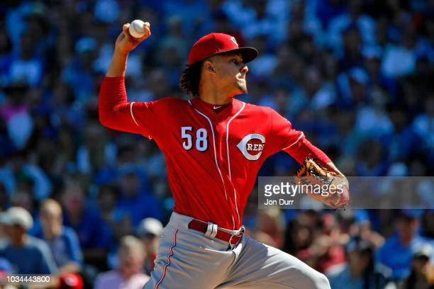 Luis Castillo of the Cincinnati Reds pitches against the Chicago Cubs during the first inning at Wrigley Field on September 16 2018 in Chicago...