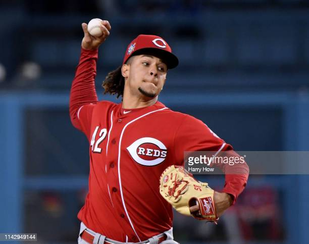 Luis Castillo of the Cincinnati Reds pitches during the first inning on Jackie Robinson Day at Dodger Stadium on April 15 2019 in Los Angeles...