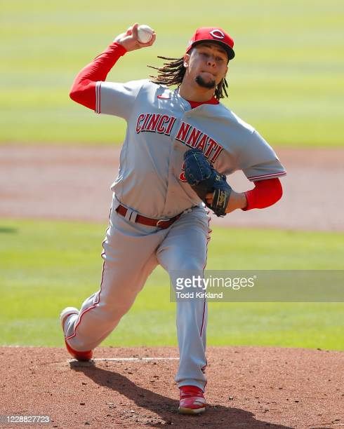 Luis Castillo of the Cincinnati Reds pitches in the first inning of Game Two of the National League Wild Card Series against the Atlanta Braves at...