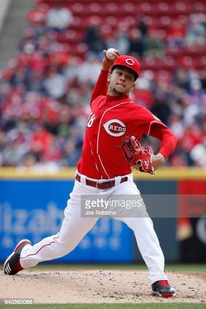 Luis Castillo of the Cincinnati Reds pitches in the first inning of the game against the Washington Nationals at Great American Ball Park on March 31...