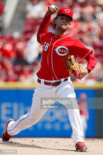 Luis Castillo of the Cincinnati Reds pitches in the first inning against the St Louis Cardinals at Great American Ball Park on June 9 2018 in...