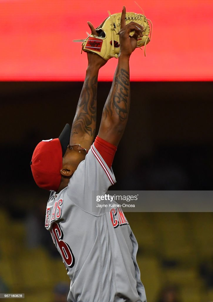 Luis Castillo #58 of the Cincinnati Reds points to the sky after earning a save in the ninth inning of the game against the Los Angeles Dodgers at Dodger Stadium on May 10, 2018 in Los Angeles, California.