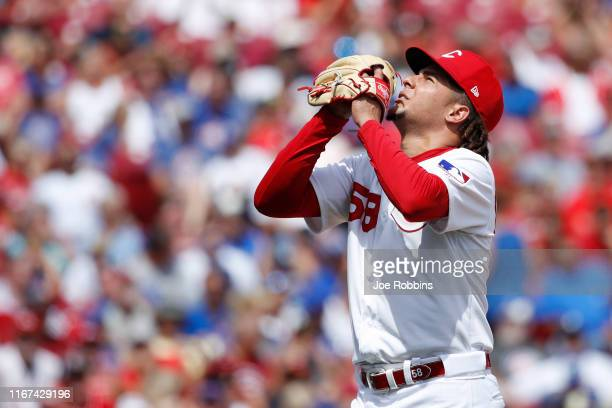 Luis Castillo of the Cincinnati Reds reacts after being taken out of the game against the Chicago Cubs in the seventh inning at Great American Ball...