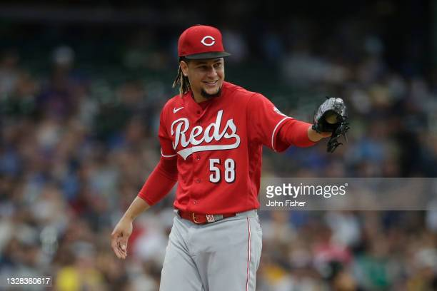 Luis Castillo of the Cincinnati Reds smiles after a play against the Milwaukee Brewers at American Family Field on July 11, 2021 in Milwaukee,...