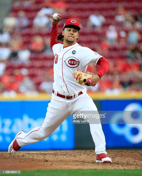Luis Castillo of the Cincinnati Reds throws a pitch against the St. Louis Cardinals at Great American Ball Park on August 16, 2019 in Cincinnati,...