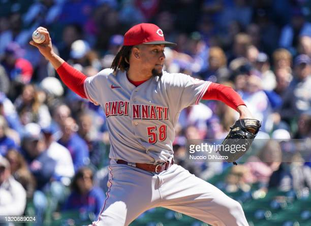 Luis Castillo of the Cincinnati Reds throws a pitch during the third inning of a game against the Chicago Cubs at Wrigley Field on May 29, 2021 in...