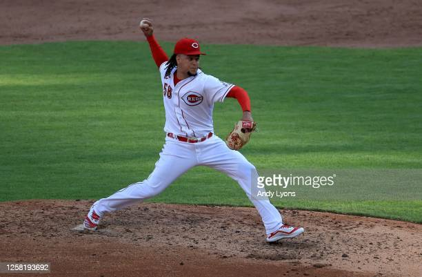 Luis Castillo of the Cincinnati Reds throws a pitch for his 500th career strikeout in the sixth inning against the Detroit Tigers at Great American...