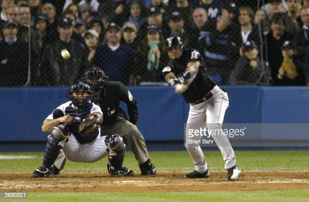 Luis Castillo of the Florida Marlins hits an RBI single to score teammate for Alex Gonzalez in the fifthe inning during game six of the Major League...