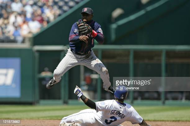 Luis Castillo of the Minnesota Twins completes a double play against the Kansas City Royals at Kauffman Stadium in Kansas City Missouri on April 27...