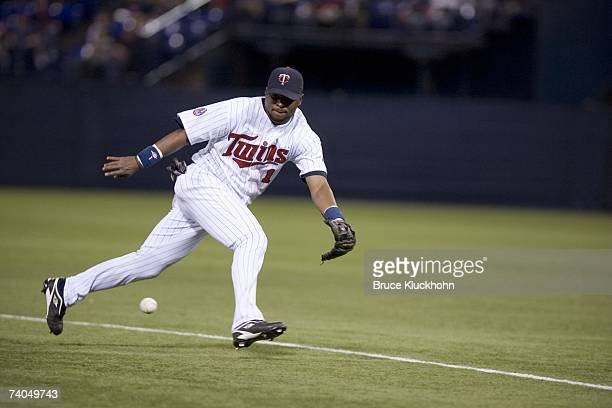 Luis Castillo of the Minnesota Twins fields the ball in the game against the New York Yankees at the Humphrey Metrodome in Minneapolis Minnesota on...