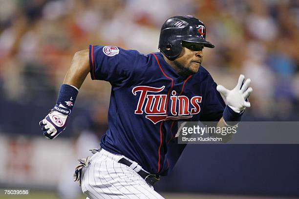 Luis Castillo of the Minnesota Twins runs to first base against the Toronto Blue Jays at the Humphrey Metrodome in Minneapolis, Minnesota on June 27,...