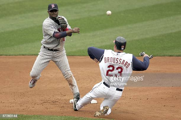Luis Castillo of the Minnesota Twins throws to first base to complete a double play while Ben Broussard of the Cleveland Indians tries to affect his...