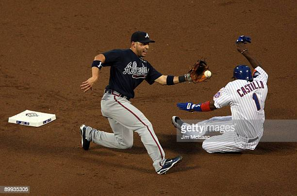 Luis Castillo of the New York Mets is tagged out attempting to steal second base in the first inning by Omar Infante of the Atlanta Braves on August...