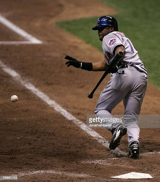 Luis Castillo of the New York Mets runs up the line after bunting the ball against the Milwaukee Brewers on July 31, 2007 at Miller Park in...