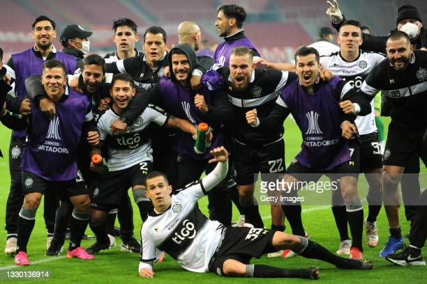 Luis Cáceres of Olimpia celebrates with teammates after qualifying to the next round in a penaltry shootout after a round of sixteen second leg match...