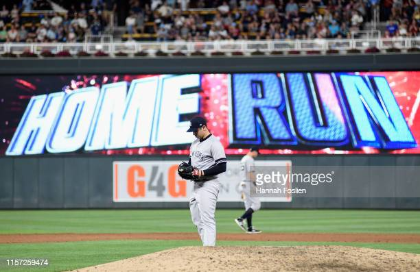 Luis Cessa of the New York Yankees looks on after giving up a solo home run to Mitch Garver of the Minnesota Twins during the sixth inning of the...