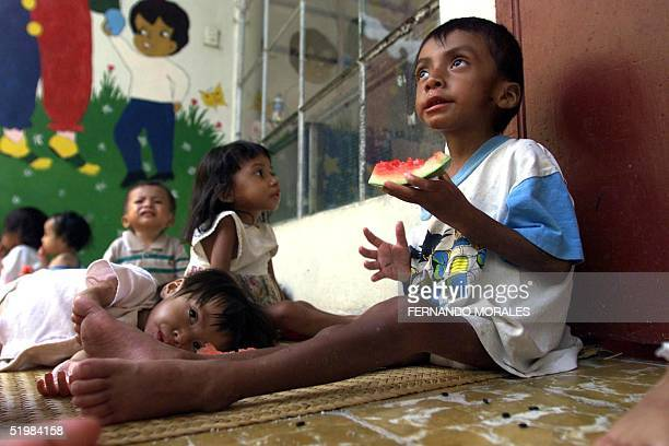 Luis Chamali eats watermelon at a health clinic in Jocotan 200kms west of Guatemala City 03 September where he and other children are being treated...
