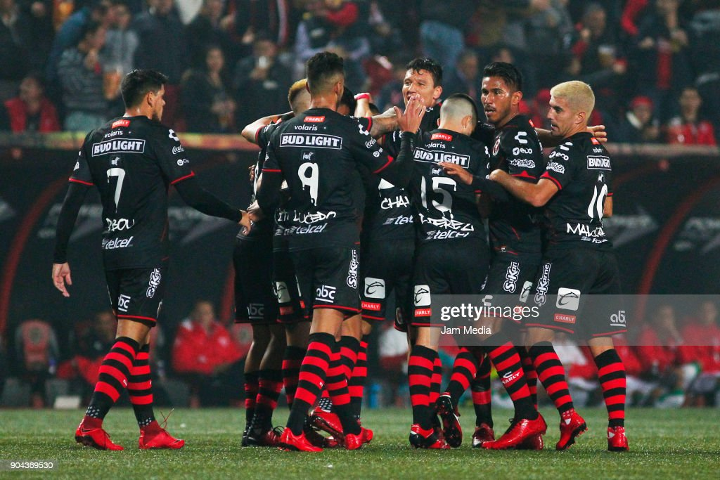 Luis Chavez of Tijuana celebrates with teammates after scoring the first goal of his team during the second round match between Tijuana and Necaxa as part of Torneo Clausura 2018 Liga MX at Caliente Stadium on January 12, 2018 in Tijuana, Mexico.
