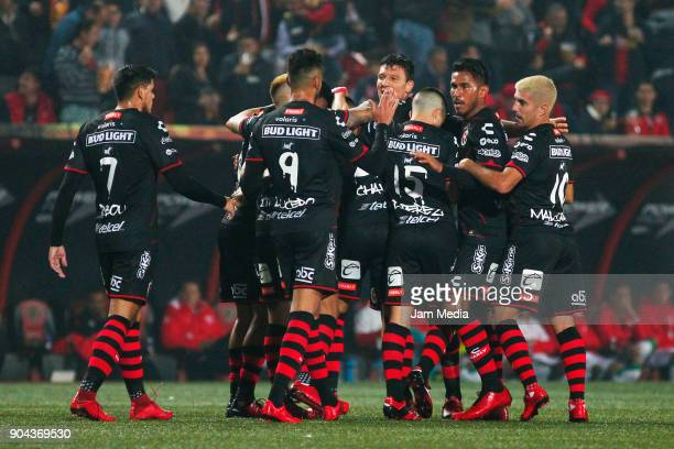 Luis Chavez of Tijuana celebrates with teammates after scoring the first goal of his team during the second round match between Tijuana and Necaxa as...