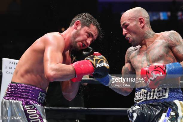 Luis Collazo lands a right hand against Bryant Perella Collazo would win by majority decision at the Nassau Veterans Memorial Coliseum on August 4...