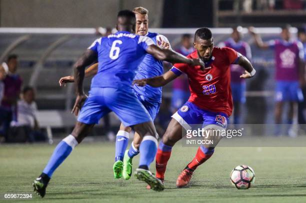 Luis Copete fights for the ball with Dukens Nazon of the Haiti National Football Team during the second match to define the last qualified to the...