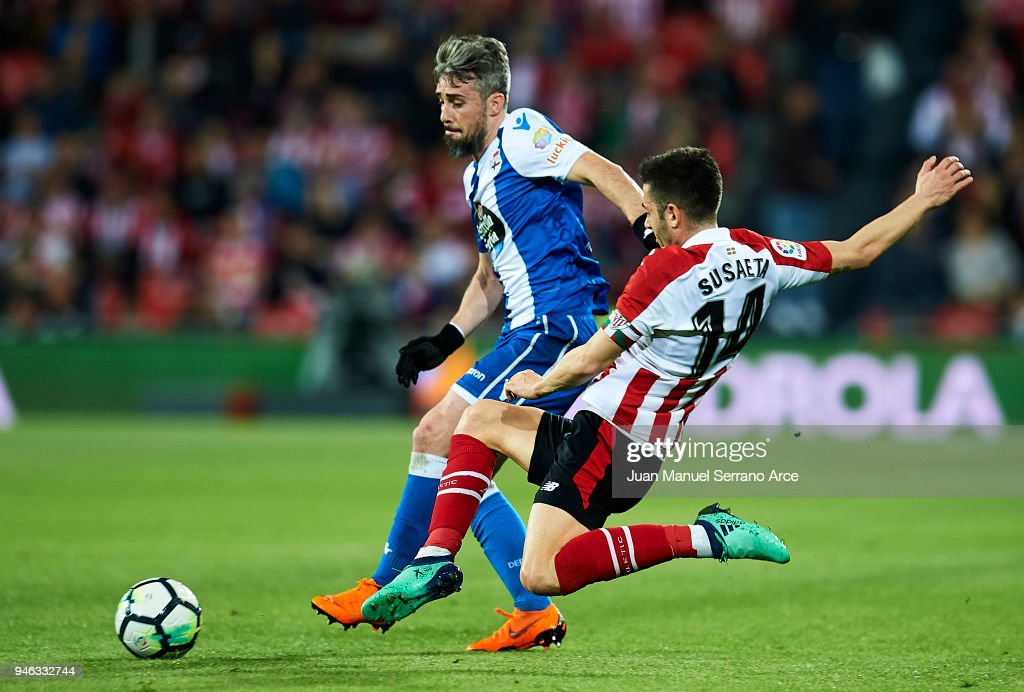 Luis Correia 'Luisinho' of RC Deportivo La Coruna competes for the ball with Markel Susaeta of Athletic Club during the La Liga match between Athletic Club Bilbao and RC Deportivo La Coruna at San Mames Stadium on April 14, 2018 in Bilbao, Spain.
