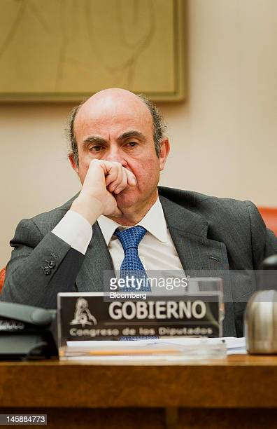 Luis de Guindos Spain's economy minister listens during a news conference in Madrid Spain on Thursday June 7 2012 Luis Maria Linde will be the next...