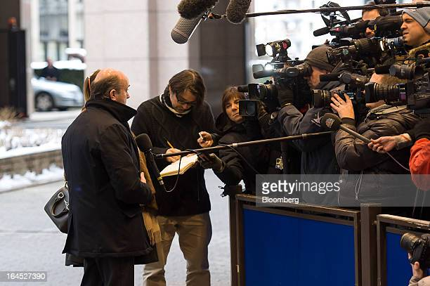 Luis de Guindos Spain's finance minister speaks to the media as he arrives for a meeting of euro area ministers in Brussels Belgium on Sunday March...