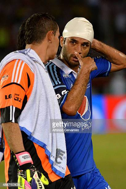 Luis Delgado and Fabián Vargas of Millonarios leave the field after the first leg semifinal match between Junior and Millonarios as part of Liga...