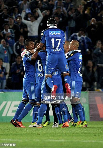 Luis Delgado goalkeeper of Millonarios celebrates with teammates after taking a penalty kick to score the first goal during a match between...