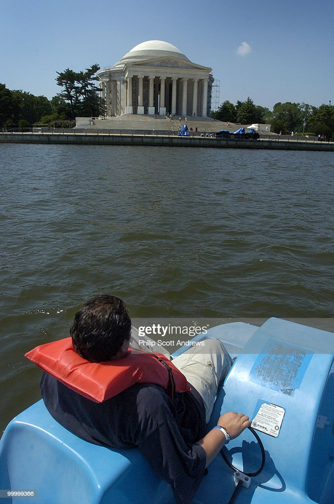 Luis Denavides paddles a paddle boat around the Jefferson Memorial tidal basin. The boats are available for rent across the basin from the memorial on weekdays and weekends except in inclement weather.
