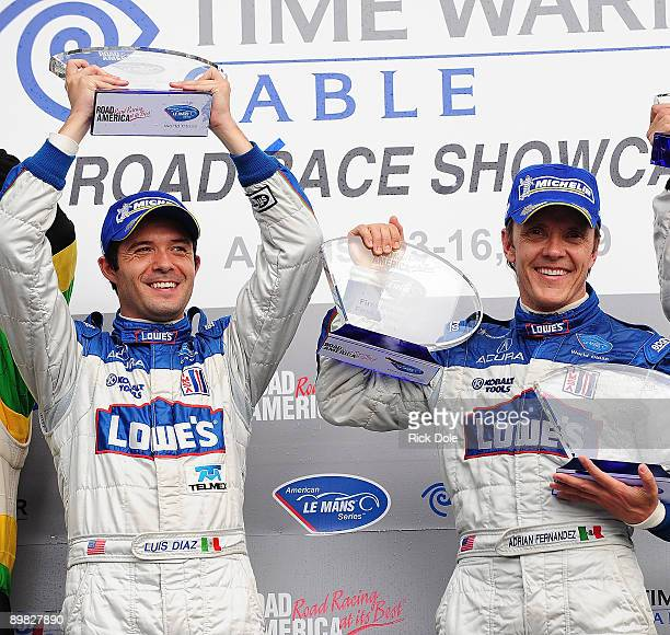 Luis Diaz and Adrian Fernandez drivers of the Lowe's Fernandez Racing Acura celebrate winning the LMP2 class during the American Le Mans Series Time...
