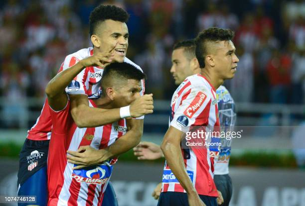 Luis Diaz David Murillo and Victor Cantillo of junior celebrate their team qualifying to the final after the semifinal second leg match between...