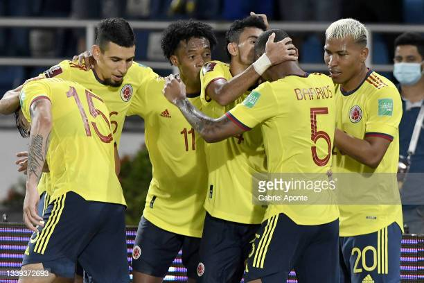 Luis Diaz of Colombia celebrates with teammates after scoring the third goal of his team during a match between Colombia and Chile as part of South...