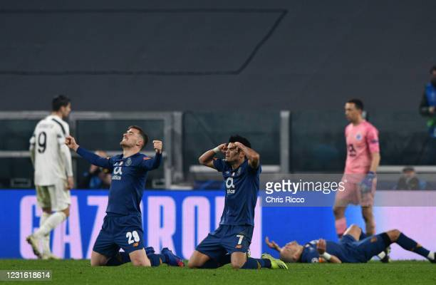 Luis Diaz of FC Porto and Toni Martinez of FC Porto celebrate the win at full time during the UEFA Champions League Round of 16 match between...
