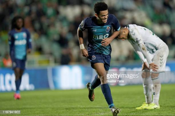 Luis Diaz of FC Porto celebrates after scoring the fourth goal of his team during the Liga NOS match between Vitoria FC and FC Porto at Estadio do...
