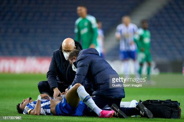 Luis Diaz of FC Porto receives a medical assistance during the Liga NOS match between FC Porto and SC Farense at Estadio do Dragao on May 10, 2021 in...