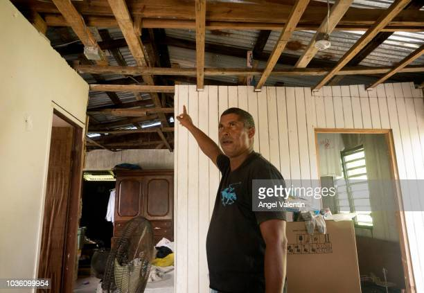 Luis E. De Jesus shows off his Hurricane Maria destroyed wooden house in the Playa Fortuna neighborhood, on September 19, 2018 in Luquillo, Puerto...