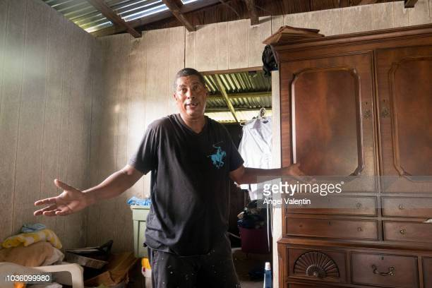 Luis E De Jesus shows off his Hurricane Maria destroyed wooden house in the Playa Fortuna neighborhood on September 19 2018 in Luquillo Puerto Rico...